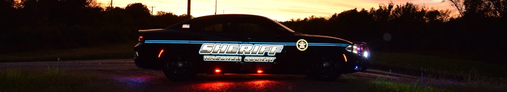 Wagoner County Sheriff's Office patrol car sideview at night